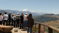 Tourists Take Photos Of Meili Xue Shan Snow Mountain In Yunnan Province China Stock Footage