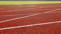 Running track with lanes on a stadium, dolly Stock Footage