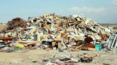 Large garbage dump waste over blue  sky Stock Footage