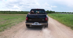 Pickup Truck Driving Down Dirt Road, Hitchhiker,Peeling Out Stock Footage