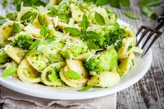 Homemade pasta orecchiette with broccoli, Parmesan cheese and basil Stock Photos