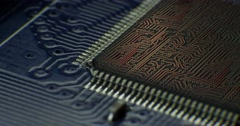 Macro shot on technology circuit board  rotating with CG and VFX . 4K  Stock Footage