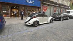 An old Beetle parked on Melentrichova Street in Prague Stock Footage