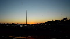 Driving POV dashcam video driving on highway at dusk in Ontario Stock Footage