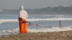 Muslim woman on the beach,Kuta,Bali,Indonesia Stock Footage