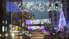Driving on Christmas decorated Gran via street at night, Madrid 06.12.2014 Stock Footage