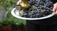 Silver salver with red wine grapes and old metal utensils. Rack Focus - stock footage