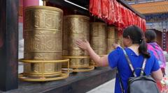 Chinese Women Spinning Tibetan Prayer Wheels Stock Footage