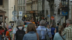 Tourists walking and waiting to cross the street near Charles Bridge in Prague Stock Footage