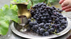 Salver with grapes and beautiful crockery Stock Footage