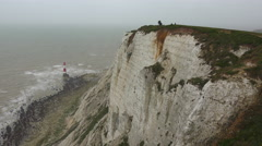 A lighthouse along the White Cliffs of Dover near Beachy Head in Southern Stock Footage