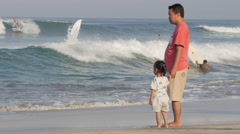 Father and daughter in the surf,Kuta,Bali,Indonesia - stock footage