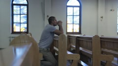 Young Man Praying in a Church - stock footage