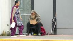 Indo Canadian Senior Passes By Homeless Man Stock Footage