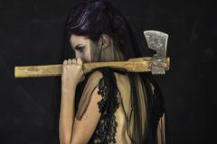 Mourning Widow with Axe - Back - stock photo