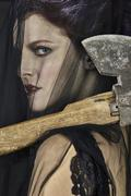 Mourning Widow with Axe - Close-up - stock photo