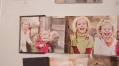 Close up of family photos on a fridge Stock Footage