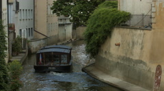 Boat floating on Certovka - a narrow water channel in Prague Stock Footage