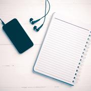 notepad and cellphone vintage style - stock photo