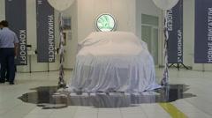Presentation of new car Skoda Superb 2015 model in the dealership showroom Stock Footage