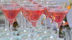 Pyramid of red blue champagne martini glasses at event tilt down Stock Footage