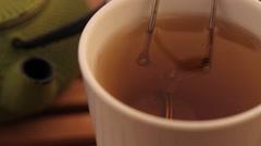 Herbal tea and green teapot - stock footage