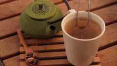 Herbal tea and teapot - stock footage