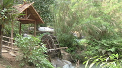 Stream and watermill in the jungle, Luang Prabang, Laos Stock Footage
