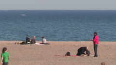 People enjoying Toronto eastern beaches on warm autumn day Stock Footage