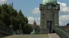 Small clock tower next to Dvorakovo nabrezi street and Vltava River, Prague Stock Footage
