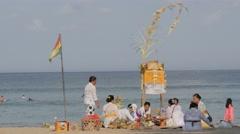 Women preparing ceremony on beach,Kuta,Bali,Indonesia Stock Footage