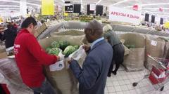 MOSCOW – SEPTEMBER 29, 2015: Black man in Ashan hypermarket Stock Footage
