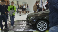 Visitors view a new car Skoda Superb during presentation in showroom Stock Footage