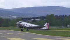 Douglas DC-3 entering air stripe front view Stock Footage