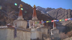 Buddhist Stupas and Prayer Flags Stock Footage