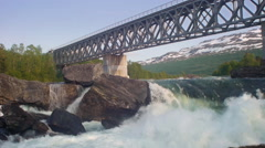 A powerfull Waterfall in under a railroad bridge Stock Footage
