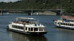 Tourist boats floating near Štvanice Island on Vltava River, Prague Stock Footage