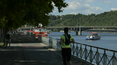 Running on Ludvík Svoboda waterfront in Prague Stock Footage