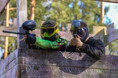Two paintball shooters defending wooden tower Stock Photos