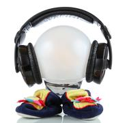Little toy martian with headphones Stock Photos