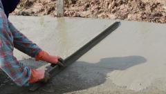 Unidentified Construction workers make shape concrete road. - stock footage