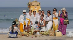Women in traditional make group photograph before ceremony,Kuta,Bali,Indonesia Stock Footage