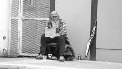 Homeless Man Smokes Cigarette By The Curb Stock Footage