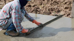 Unidentified Construction workers make shape concrete road. Stock Footage