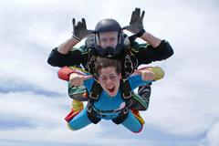 Skydiving tandem girl Stock Photos