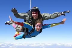 Skydiving tandem happy - stock photo