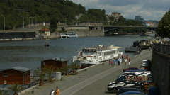 Tourists walking on the riverside in Prague Stock Footage