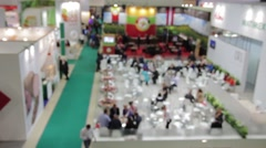 Business people at the trade fair - stock footage