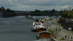 View of Stefanik bridge and tourists walking on the riverside, Prague Stock Footage