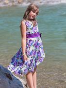 Cute preteen long hair girl on riverbank Stock Photos